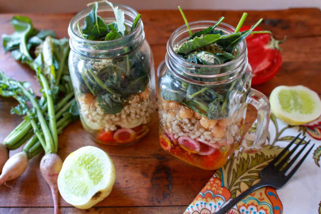 healthy salad in two mason jars